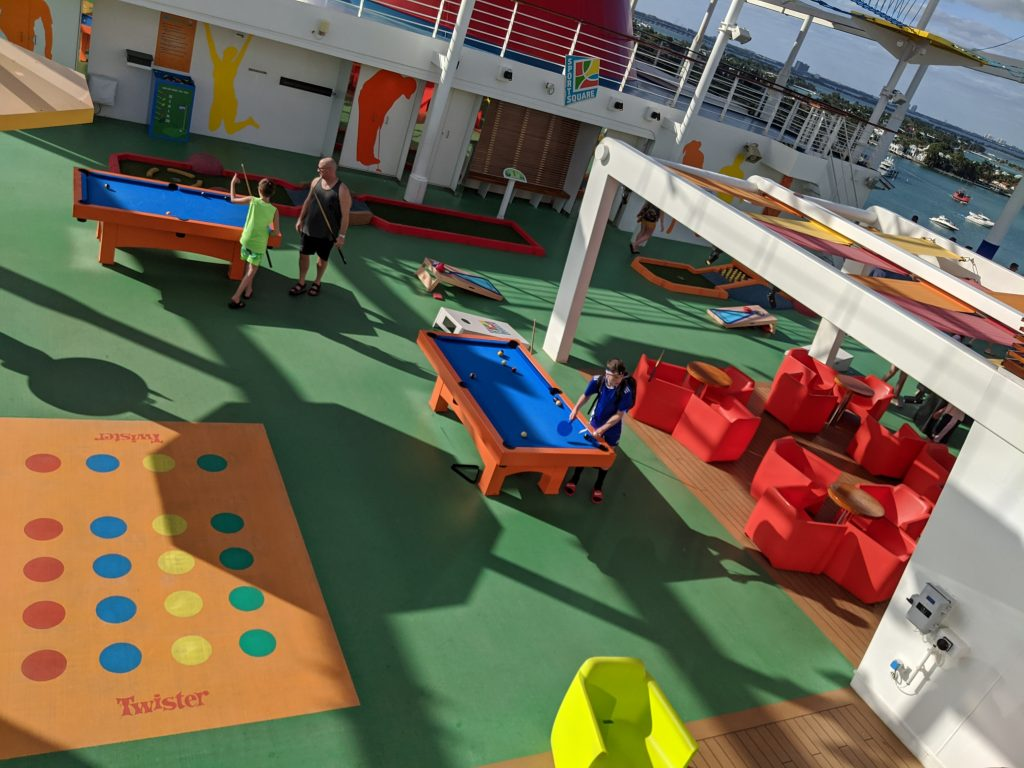 Twister, pool, and cornhole in the Sports Square on the Carnival Horizon