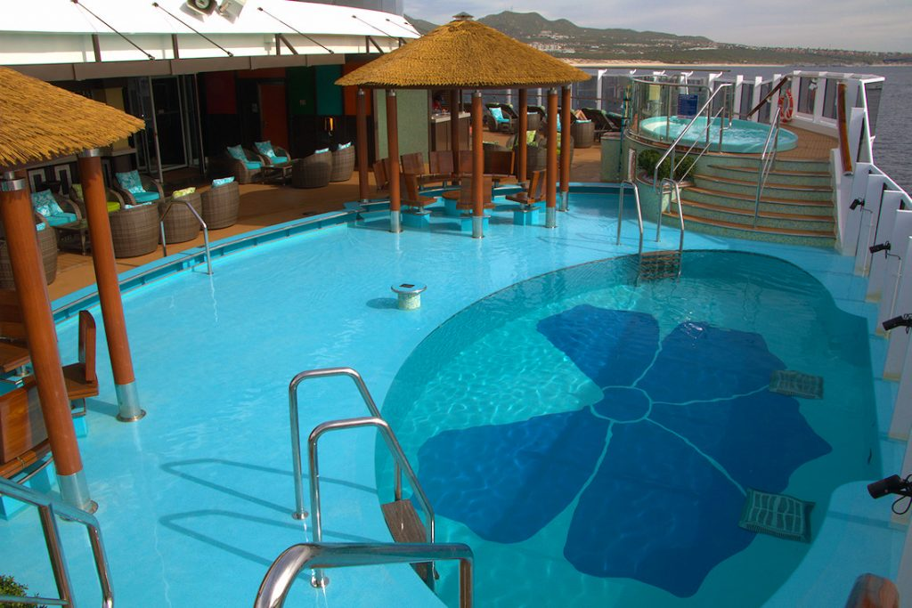 Havana deck area with 2 hot tubs and an infinity pool on the Carnival Panorama