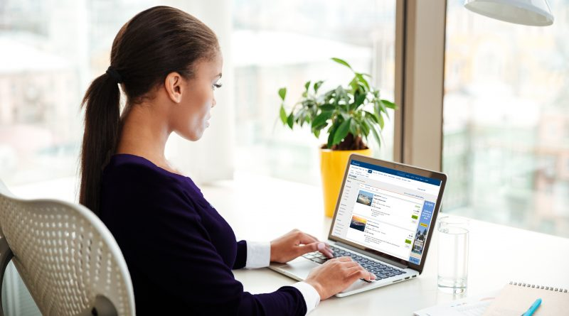 Woman booking a cruise vacation using a website