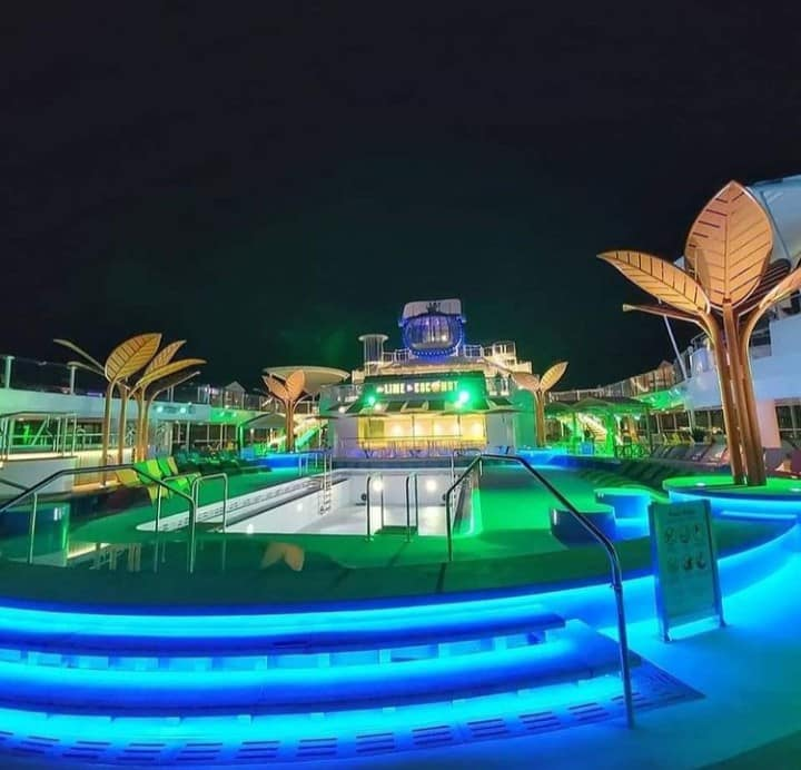 The Caribbean themed Pool Deck really lights up at night