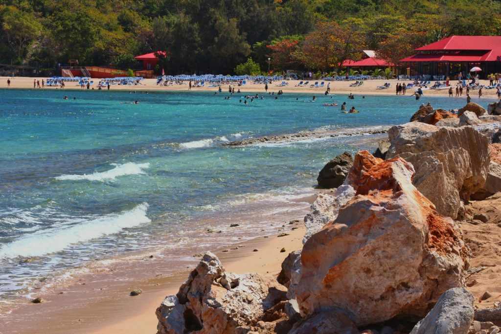 Colorful rocks lining the beach in Labadee
