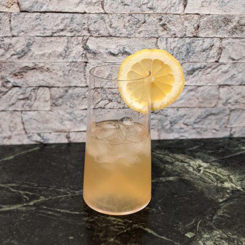 Cocktail glass with Carnival's Alchemy Bar Lynchburg Lemonade