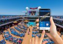 iPhone with Carnival Hub app installed on the Carnival Horizon