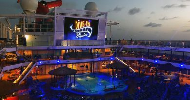 Night-time dive-in theater showing on a movie screen on the Carnival Vista