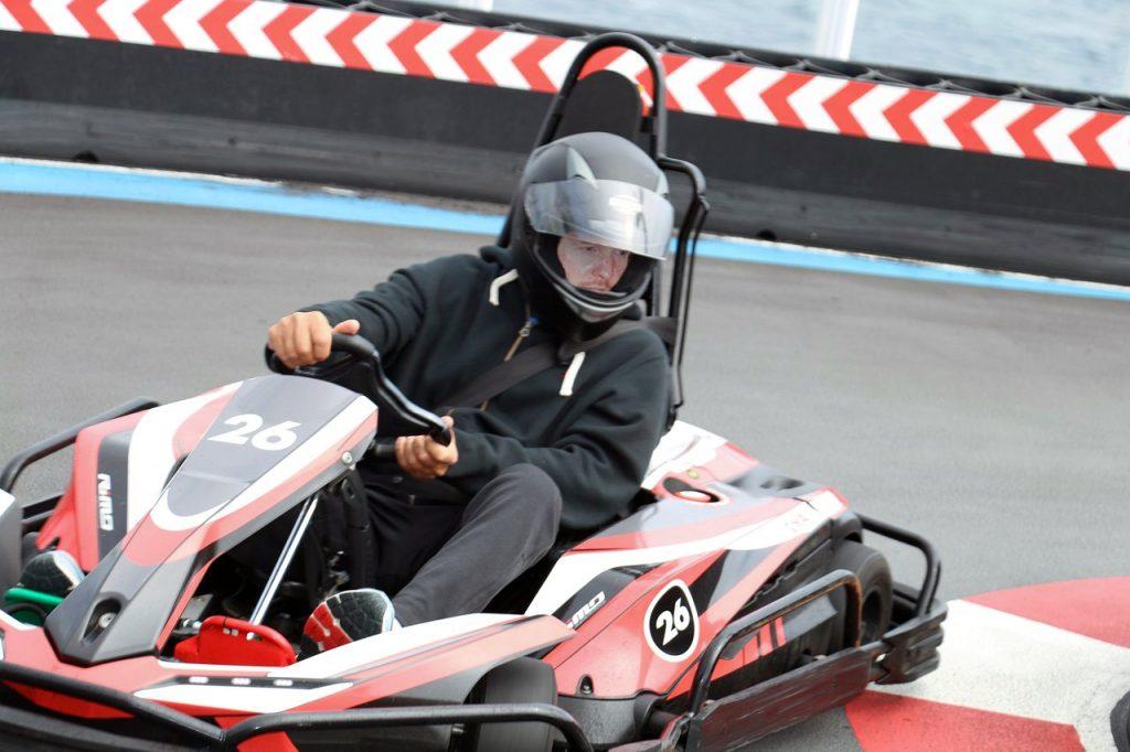 Man driving go kart on Norwegian Bliss Speedway race track