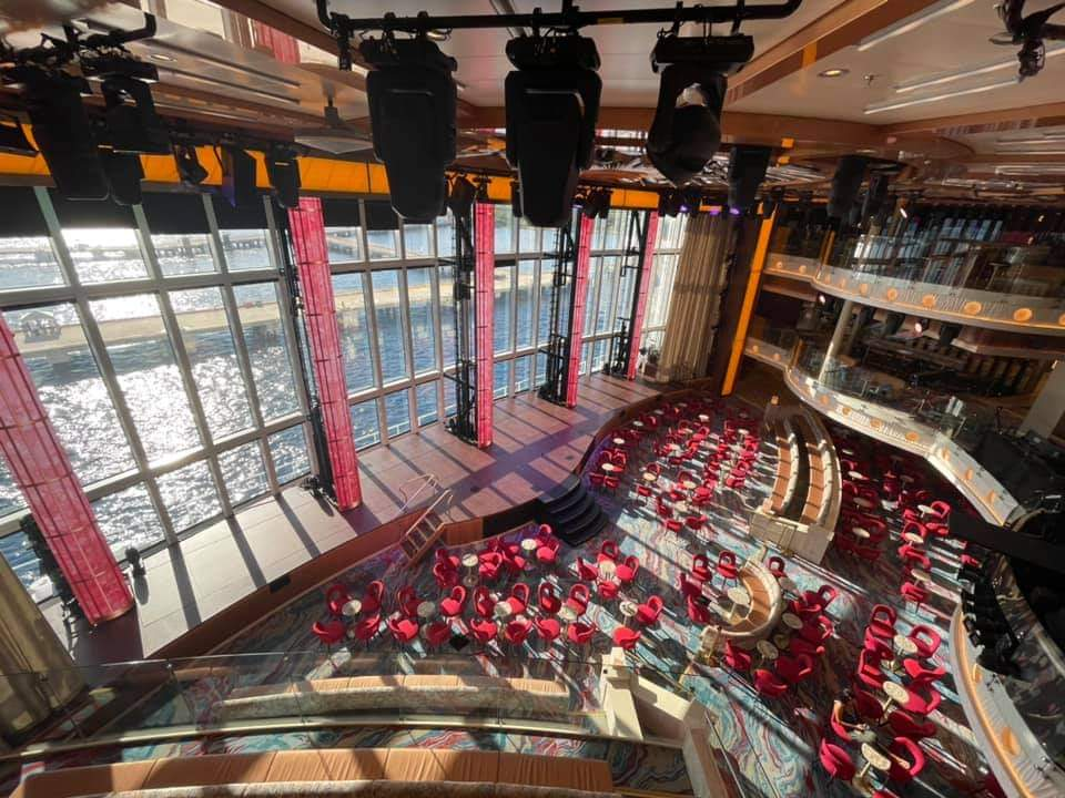 Carnival Grand Central Atrium with 3-story glass windows overlooking the Ocean