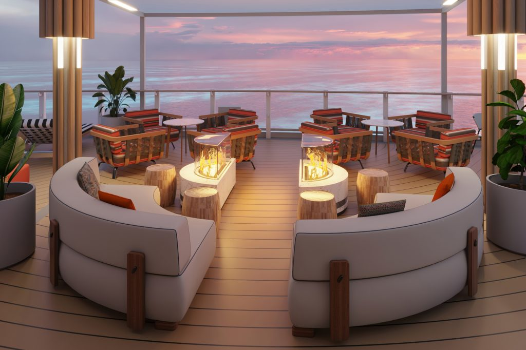 Fire pit with couches on a cruise ship deck with ocean in background